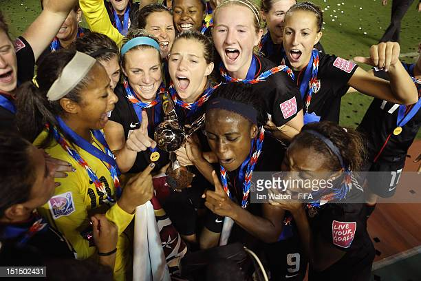 The USA team celebrates with the trophy after winning the FIFA U20 Women's World Cup Final match between USA and Germany at the National Stadium on...