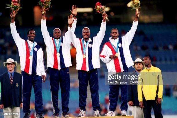 The USA team celevrates winning the gold medal Michael Johnson Alvin Harrison Calvin Harrisson and Antonio Pettigrew