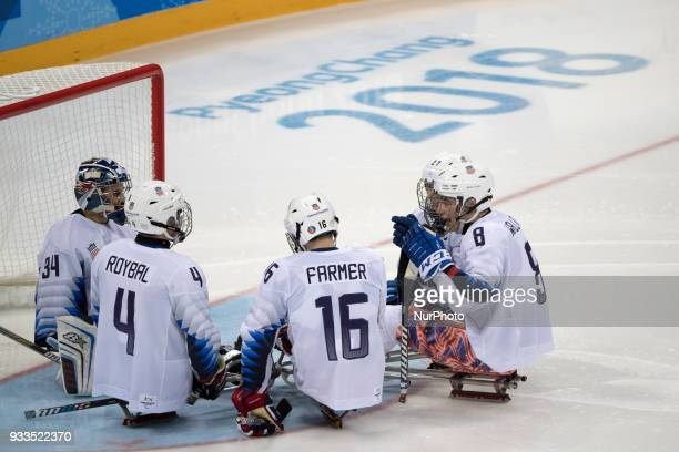 The USA team is concentrating before the start of third time during The Ice Hockey gold medal game between Canada and United States during day nine...