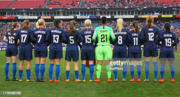 The USA team pose in jerseys honoring inspirational women from back Row Rose Levelle Tobin Heath Abby Dahlkemper Alex Morgan Kelley O'Hara Megan...