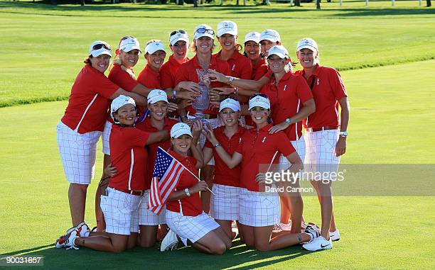 The USA team pose with the trophy after defeating the European Team at the 2009 Solheim Cup Matches at the Rich Harvest Farms Golf Club on August 23...