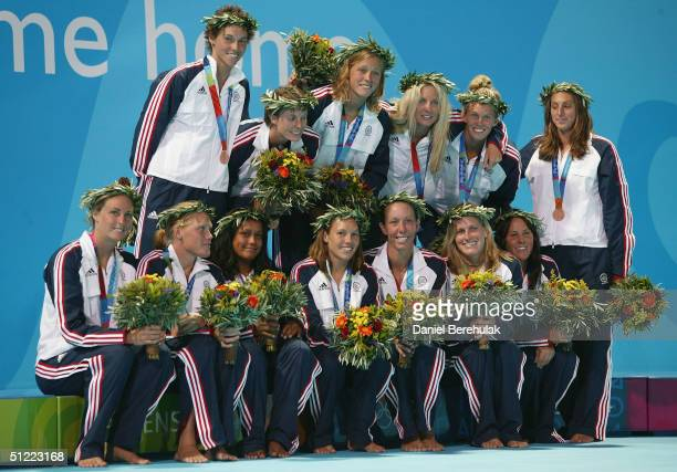 The USA team poses fro photogarphers with their bronze medals after the medal ceremony for women's Water Polo on August 26 2004 during the Athens...