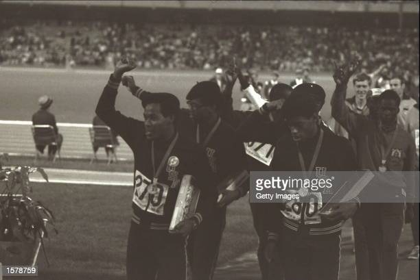 The USA team which won the 4 by 400 metres relay in a world record breaking performance leave the arena holding aloft clenched fists at the 1968...