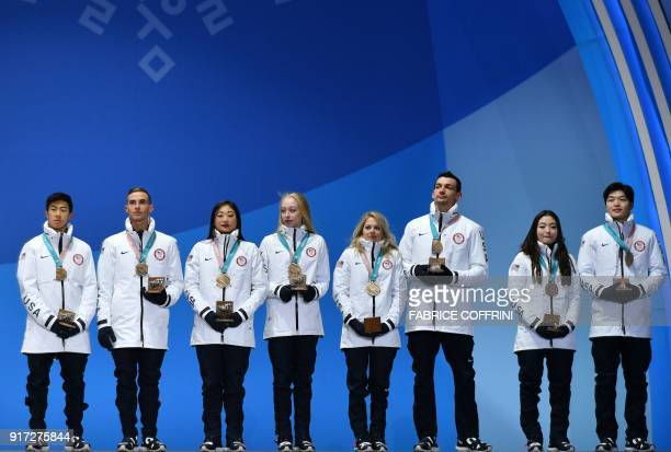 The USA team who won bronze pose on the podium during the medal ceremony for the figure skating team event at the Pyeongchang Medals Plaza during the...