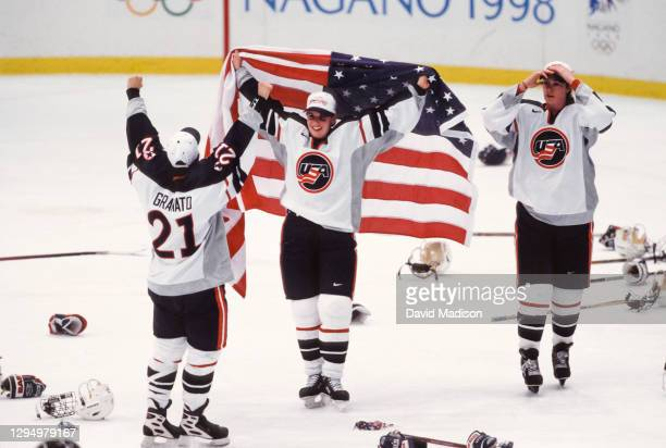 The USA Women's Ice Hockey team celebrates winning the Olympic gold medal match against Canada during the 1998 Winter Olympics on February 17, 1998...