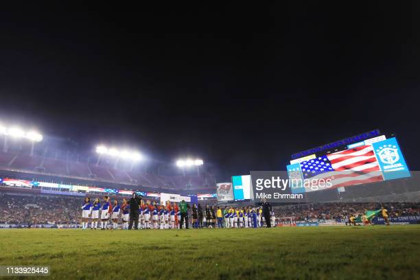 The USA Women's National team stand during the national anthem before a game against Brazil during the She Believes Cup at Raymond James Stadium on...