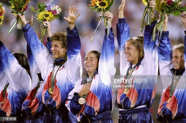 The USA women''s soccer team celebrate on the podium after defeating China 21 to win the gold medal in the 1996 Olympic Games at Sanford Stadium in...