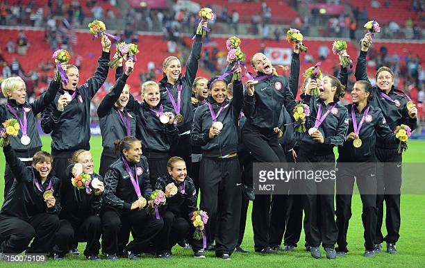 The USA women's soccer team celebrates with their gold medals following a 21 victory over Japan in the Olympics women's soccer final at Wembley...