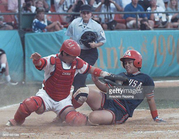 The USA Women's Softball team defeated China 3 –1 in Columbus Georgia to win the gold medal USA's Kim Maher slides safely into home to score the 3rd...