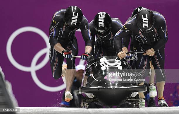 The USA1 bobsled team of Steven Holcomb Curtis Tomasevicz Steven Langton and Christopher Fogt at the start of their first qualifying run during the...