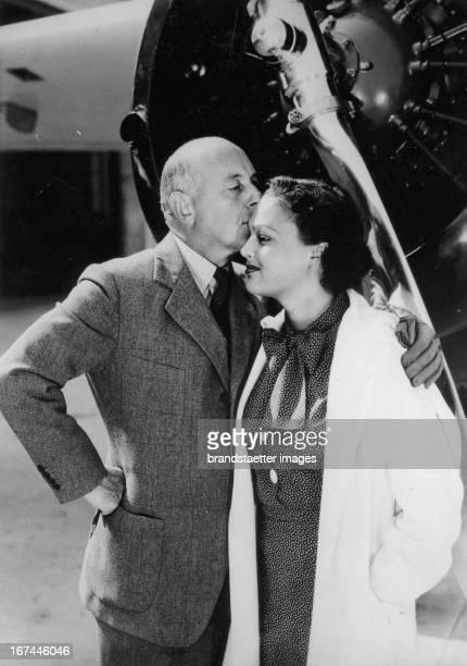 The USamerican director and producer Cecil Blount DeMille with his adopted child Katherine 1934 Photograph Der USamerikanische Regisseur und...