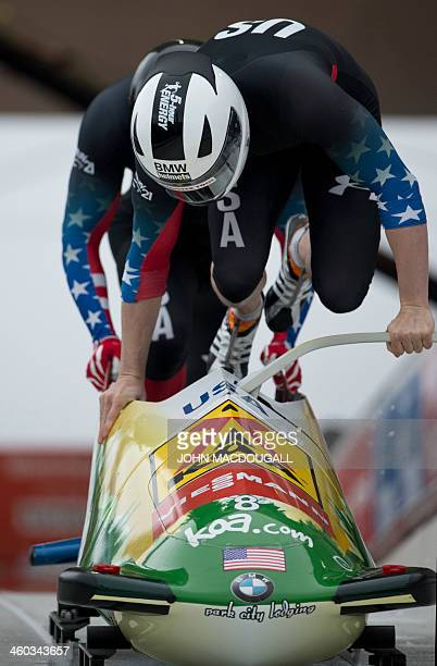 The USA's Cory Butner and Charles Berkeley take the start in the Two-Men Bob event of the Bob and Skeleton World Cup in Winterberg, central Germany,...