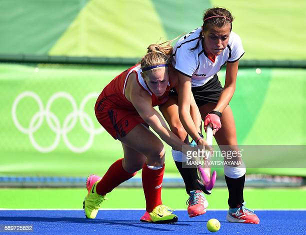 The USA's Katie Bam vies with Germany's Selin Oruz during the women's quarterfinal field hockey USA vs Germany match of the Rio 2016 Olympics Games...
