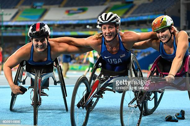 The USA's Tatyana McFadden who won the 5000M in wheelchair racing celebrates with the USA's Chelsea McClammer and Amanda McGrory during the Rio 2016...