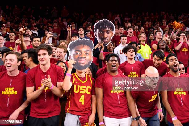 The USC students cheer during the college basketball game between the UCLA Bruins and the USC Trojans on March 7 2020 at Galen Center in Los Angeles...