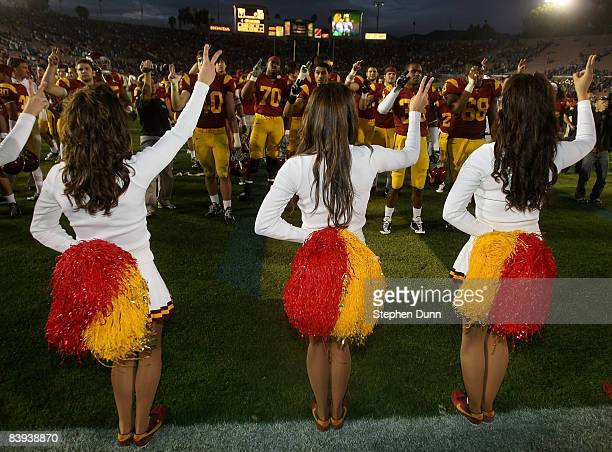The USC Trojan cheerleaders and football players sing the fight song after the Trojans' 28-7 victory over the UCLA Bruins on December 6, 2008 at the...