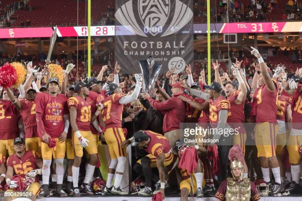 The USC Trojans celebrate winning the Pac12 Championship game against the Stanford Cardinal on December 1 2017 at Levi's Stadium in Santa Clara...