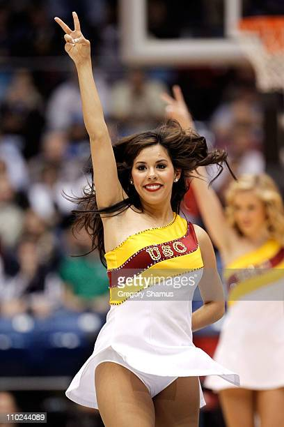 The USC Trojans cheerleaders perform on the courg during the game against the Virginia Commonwealth Rams during the first round of the 2011 NCAA...
