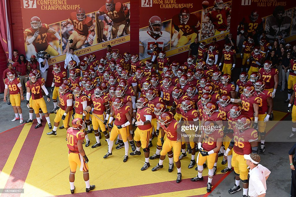 The USC Trojans enters the field for the game against the Utah State Aggies at the Los Angeles Memorial Coliseum on September 21, 2013 in Los Angeles, California.