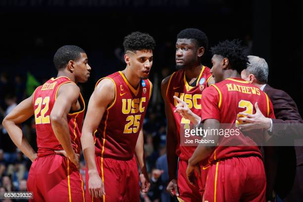 The USC Trojans huddle with head coach Andy Enfield in the second half against the Providence Friars during the First Four game in the 2017 NCAA...