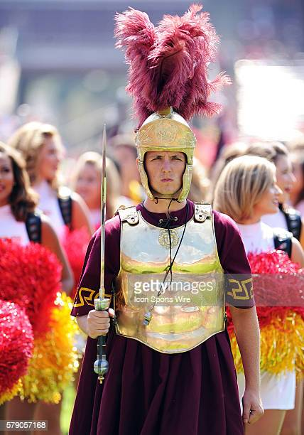 The USC Trojans mascot is escorted onto the field by the USC cheerleaders and band before the start of a NCAA football game between the University of...