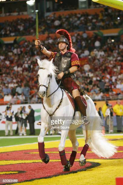 The USC Trojans mascot, Traveler, appears with a Trojan warrior astride during the 2005 FedEx Orange Bowl National Championship game against the...