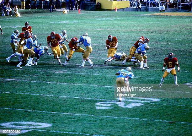 The USC Trojans run the ball during an NCAA game against the UCLA Bruins on November 20, 1982 at the Rose Bowl in Pasadena, California.