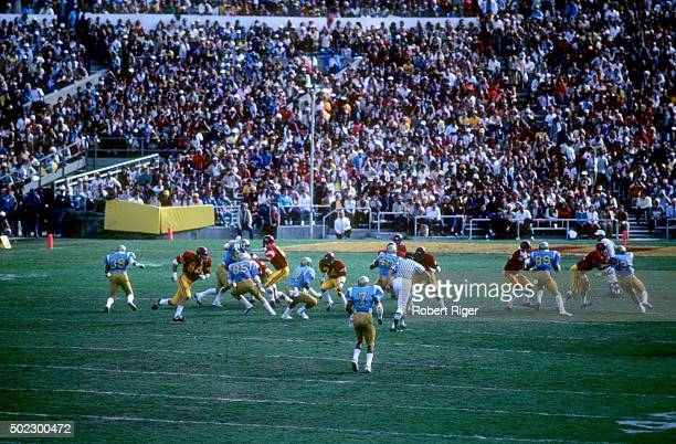 The USC Trojans run the play against the UCLA Bruins during an NCAA game on November 20, 1982 at the Rose Bowl in Pasadena, California.