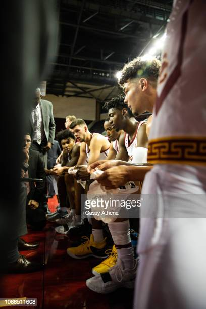 The USC Trojans sit together during a timeout in a game against the Vanderbilt Commodores at The Galen Center on November 11 2018 in Los Angeles...