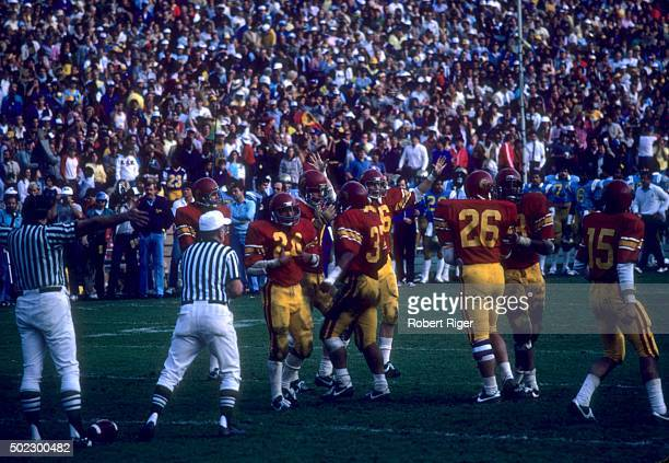 The USC Trojans stand on the field against the UCLA Bruins during an NCAA game on November 20, 1982 at the Rose Bowl in Pasadena, California.
