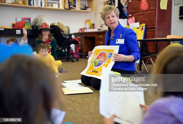 The USDA's Angela Tagtow talks with preschoolers about nutrition Monday at Flagstaff Academy The St Vrain Valley School District has won the USDA's...