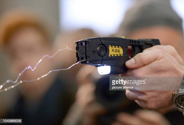 The use of a taser is demonstrated as part of the internal affairs committee at the state police school in Berlin Germany 18 November 2013 A meeting...