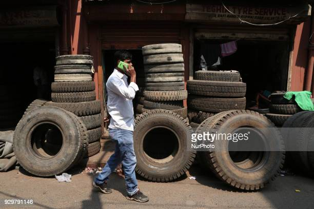 The Used Tyre repair a Narrow Side Street in Kolkata city before they are sold in a secondhand Motors Parts Market ALL SIZES Brand GOODYEAR CEAT...