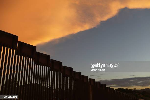The USMexico border fence is seen at sunset on July 22 2018 in Nogales Arizona President Trump has proposed replacing the fence with a wall