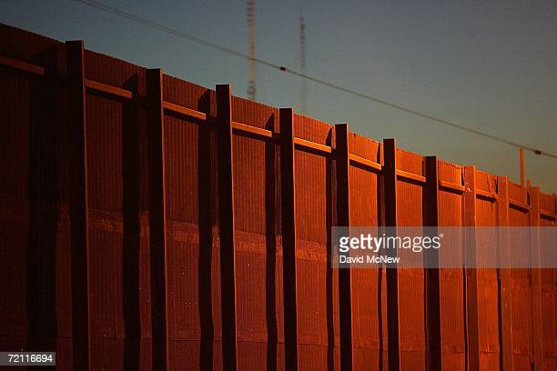 The USMexico border fence is seen on October 7 2006 in Calexico California SFish and Wildlife Service wardens and environmentalists warn that a...