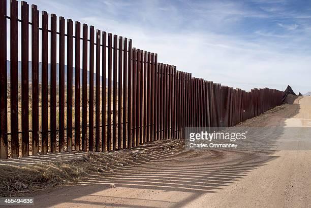 The USMexico border fence stretches into the countryside on January 21 2014 near Naco Arizona