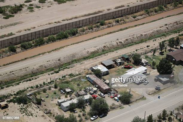 The US/Mexico border with Mexico at top is seen on June 19 2018 in El Paso Texas The Trump administration is enforcing a policy of zero tolerance in...