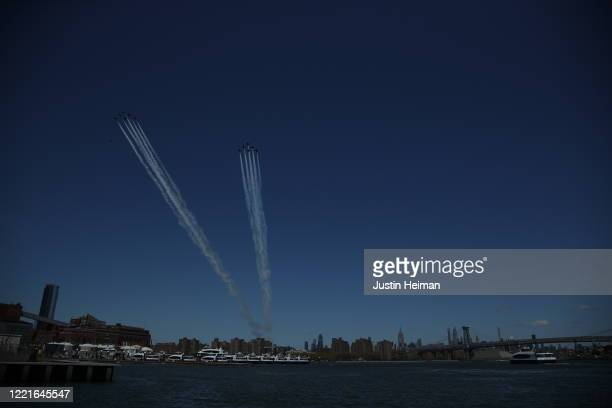 The USN Blue Angels and the USAF Thunderbirds fly over the East River to pay tribute to NYC COVID19 Frontline Workers at the Brooklyn Navy Yard on...