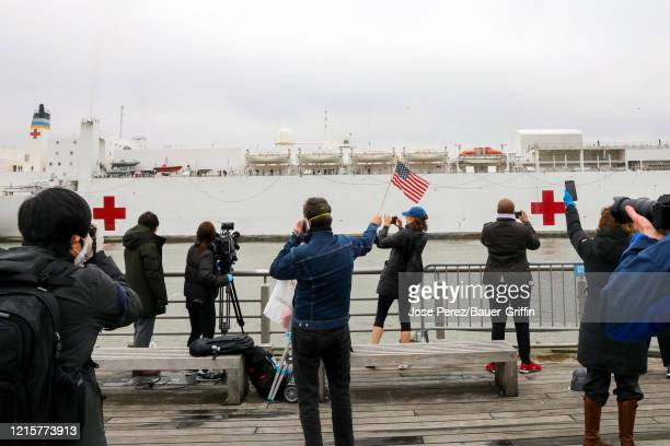 The USNS Comfort a US Navy hospital ship arrives at New York Harbor during the coronavirus pandemic on March 30 2020 in New York City The ship brings...