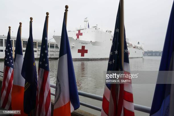 The USNS Comfort hospital ship is docked at Pier 90 on March 30 2020 in New York A military hospital ship arrived in New York Monday as America's...