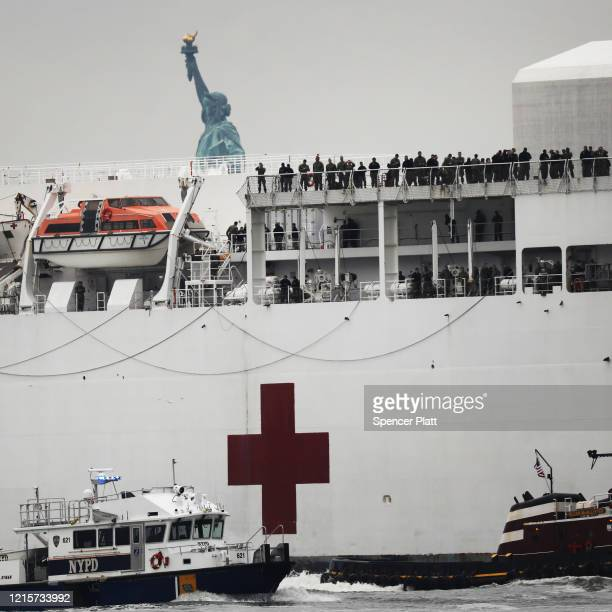The USNS Comfort hospital ship travels up the Hudson River as it heads to Pier 90 on March 30 2020 seen from Battery Park in New York City The...