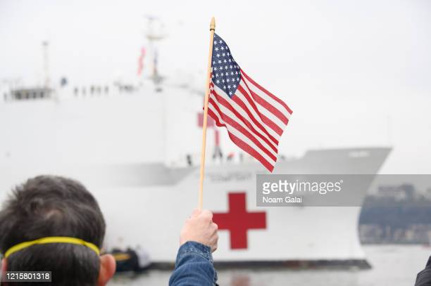 The USNS Comfort hospital ship travels up the Hudson River as it heads to Pier 90 during the Coronavirus pandemic on March 30 2020 in New York City...