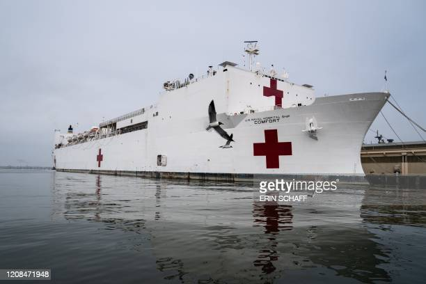 The USNS Comfort is docked at Naval Station Norfolk in Norfolk Virginia on March 28 2020 The hospital ship will depart for New York City on March 28...