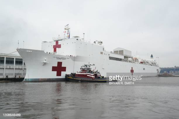 The USNS Comfort is docked at Pier 90 on March 30 2020 in New York A military hospital ship arrived in New York Monday as America's coronavirus...
