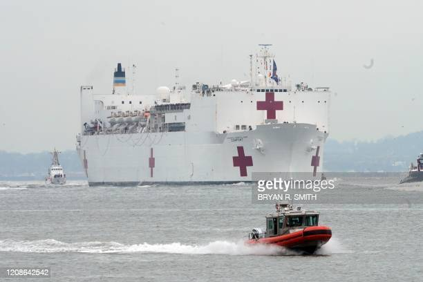 The USNS Comfort medical ship moves up the Hudson River as it arrives on March 30 2020 in New York A military hospital ship arrived in New York...