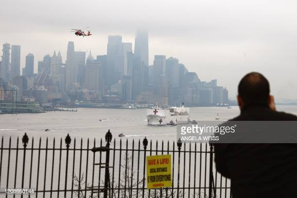 The USNS Comfort medical ship moves up the Hudson River as it arrives on March 30 2020 in New York as seen from Weehawken New Jersey A military...