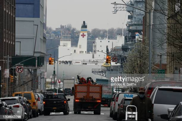 The USNS Comfort medical ship moves up the Hudson River in the distance as it arrives on March 30 2020 in New York A military hospital ship arrived...
