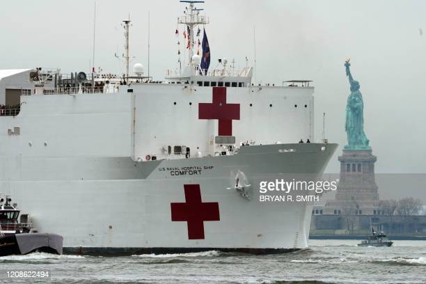 The USNS Comfort medical ship moves up the Hudson River past the Statue of Liberty as it arrives on March 30 2020 in New York A military hospital...