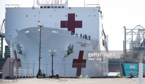 The USNS Mercy Navy hospital ship is moored after it arrived in the Port of Los Angeles to assist with the coronavirus pandemic on March 27 2020 in...