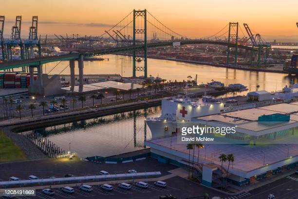 The USNS Mercy Navy hospital ship is seen at dawn in the Port of Los Angeles after it arrived to assist with the coronavirus pandemic on March 28...